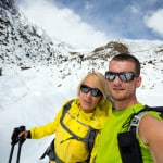 Couple hikers man and woman doing selfie portrait on expedition in winter mountains. Inspiration and motivation. beautiful nature landscape. Fitness healthy lifestyle outdoors on snow in Himalayas, Nepal, Annapurna range trekking.
